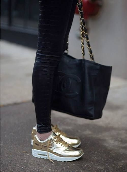 gold sneakers. reptile print leggings. chanel shoulder bag.