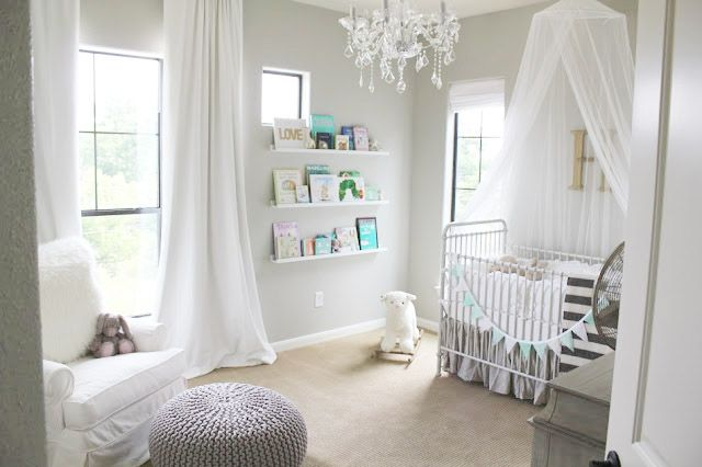 Pale grey and white babies room. Very elegant. Gender neutral. Can add pops of colour. Versatile. Relaxing.