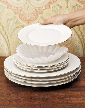 "Coffee Filter Cushions: To protect your fine china while it's in storage, try placing coffee filters between the dishes. ""I'm always looking for inexpensive solutions to common problems,"" says Country Living Decorating Editor Frances Bailey. ""Why not use what's most handy?"""