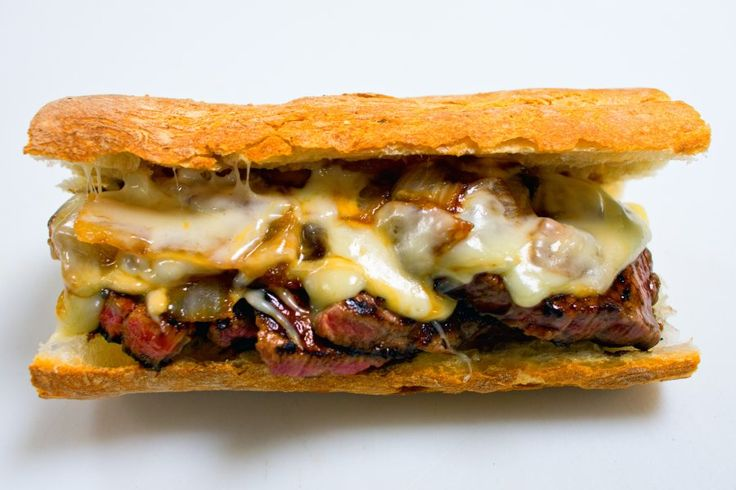 Pat LaFrieda's filet mignon sandwich contains Monterey jack cheese, sweet onions, and is served au jus on a toasted baguette.
