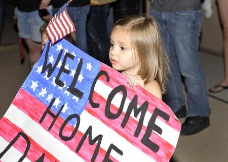 Gracie Sutton, 4, awaits the return of her father, U.S. Air Force 1 LT Christopher Sutton, 318th Special Operations Squadron, from deployment, on Cannon Air Force Base, N.M., July 2, 2011. Gracie and her family was one of the families and friends who gathered to welcome their loved ones home.    Read more: http://www.dvidshub.net/image/618104/operation-homecoming##ixzz1zvmBXBut
