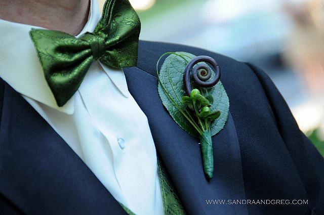 boutonniere, featuring fiddle head fern, berries and bear grass