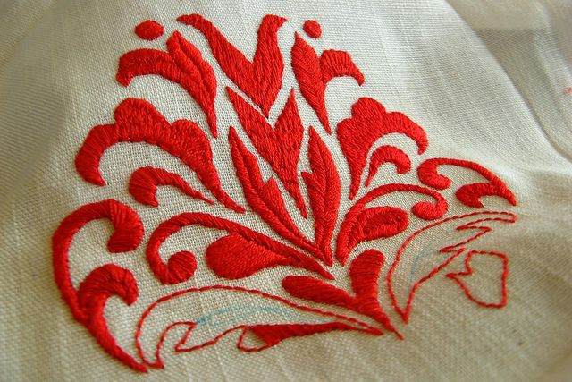 back stitch outline and filled with long and short, satin stitches