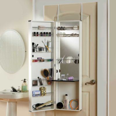 If you don't have a wall to hang a medicine cabinet or shelving unit, add an over-the-door beauty armoire - it's a great small bathroom storage idea.