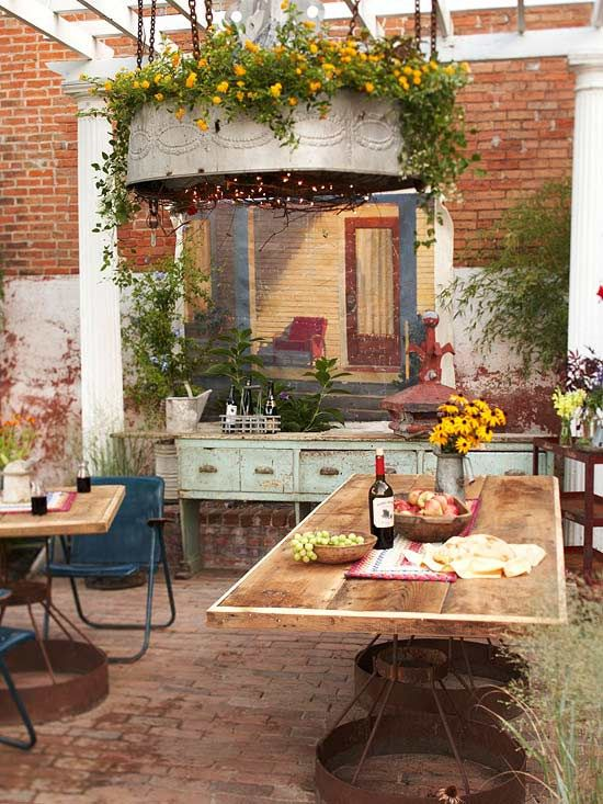 I love the rustic, repurposed look of this patio.... so pretty!