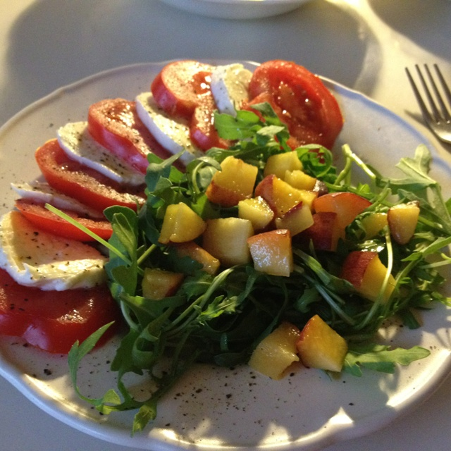 summer salad of arugula and peach with passion fruit vinegar dressing ...
