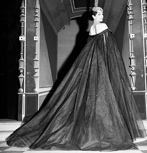 Actress Andrea Parisy wearing an evening gown by Jean Patou, 1954.