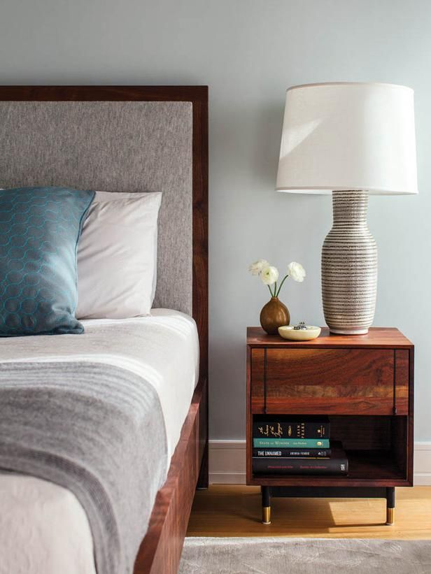 Accessories in this master bedroom are kept to a minimum to keep the design simple and sleek.