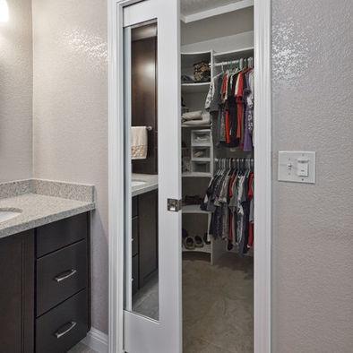 Walk in closet with mirrored pocket door dream home for Doors for walk in closet
