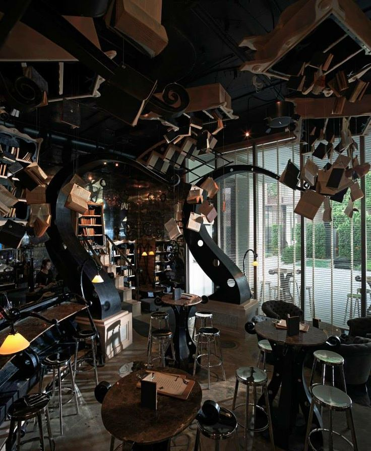 The BookShop Restaurant - @Cait I picture an area something like this, only less creepy and not so damaging to the books.
