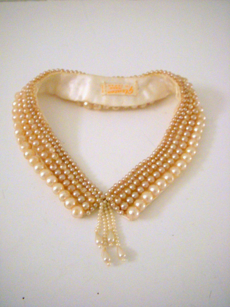 50s Vintage Pearl Collar Necklace Ivory Faux Pearl Cluster Collar Made In Japan. $24.00, via Etsy.