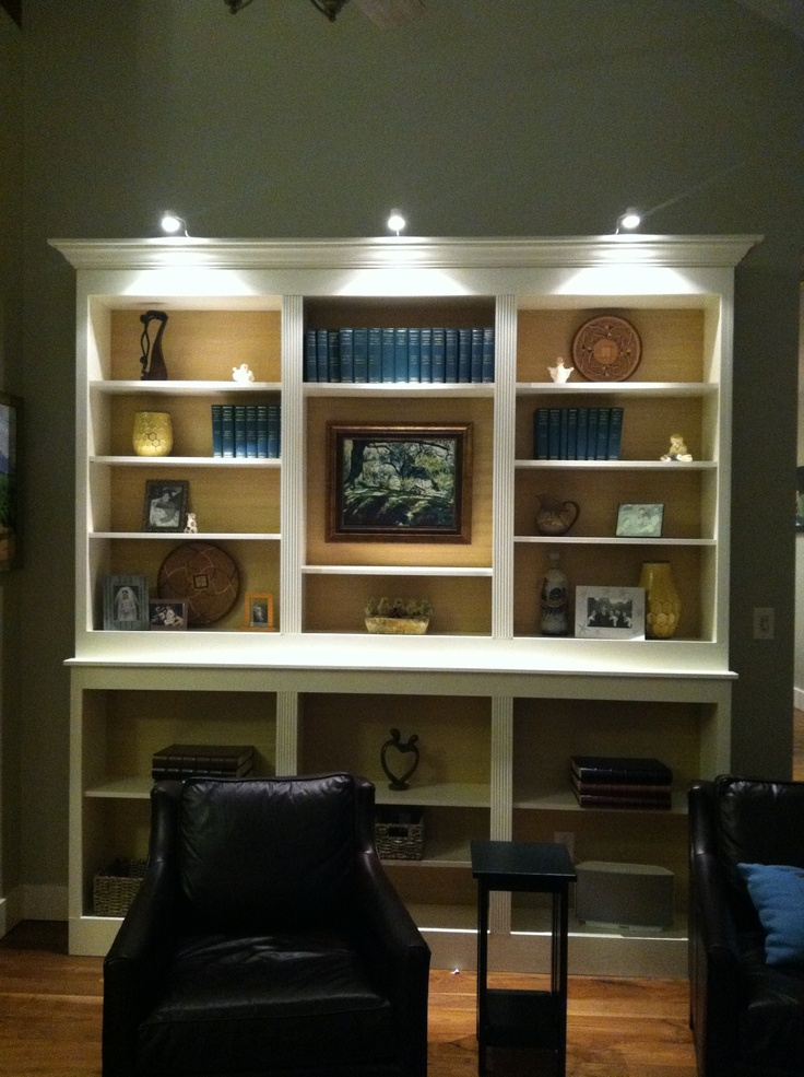 We put in built in bookshelves using ikea billy bookcases back lined with grasscloth design by - Inbuilt bookshelves ...