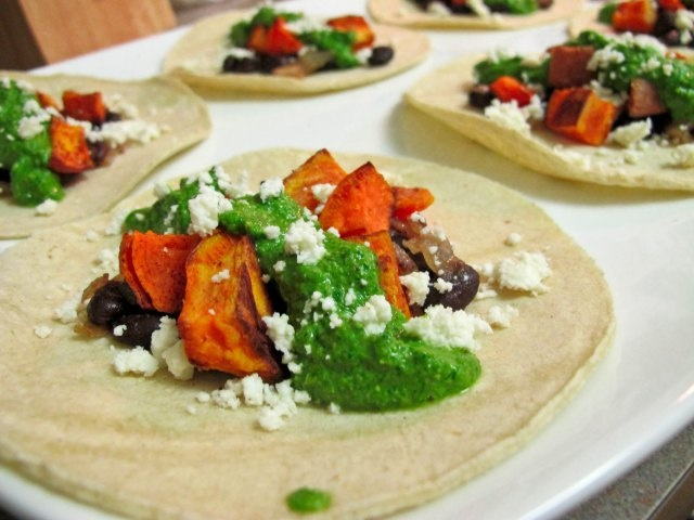 sweet potato and black bean tacos with swiss chard pesto