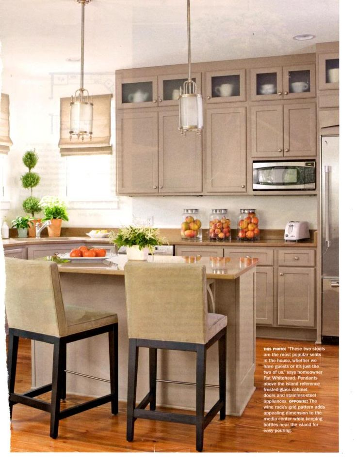 glass top cabinets + pendants + island table + taupe kitchen palette