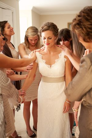 All the girls praying over the bride before the wedding. What can be better?