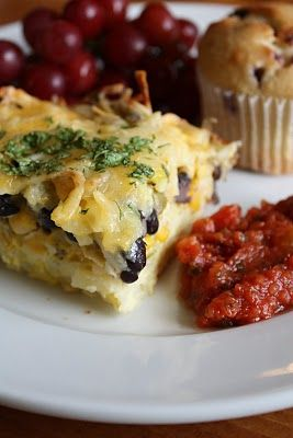 ... black beans, cheese, green chilis, and eggs, plus topped with salsa