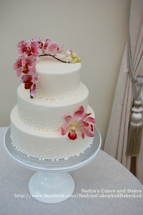 Beautiful Orchids on a wedding show cake by NadyasCakesAndBakes