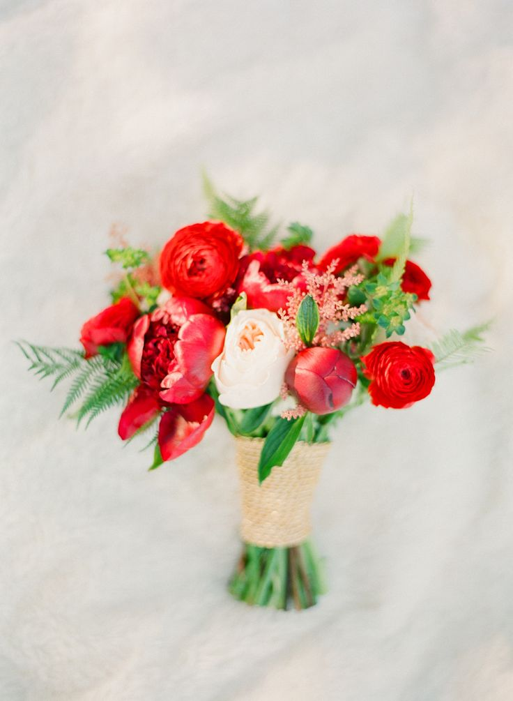 Red Bouquet | Photography: Jordan Brittley | See the shoot on SMP Weddings: http://www.stylemepretty.com/2013/12/23/christmas-themed-engagement/