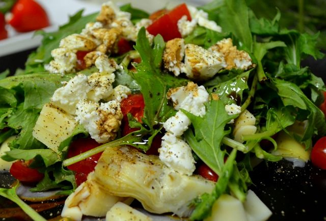 ... Greens Salad with Hearts of Palm, Artichoke Hearts and Goat Cheese