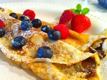 Nutella-Filled Crepes with Berries & Whipped Cream