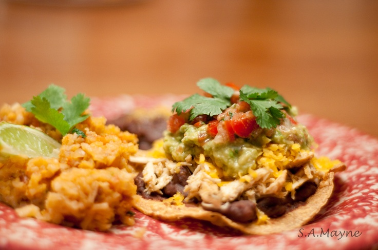 Roasted chicken tostada with homemade guacamole, fresh salsa, and ...