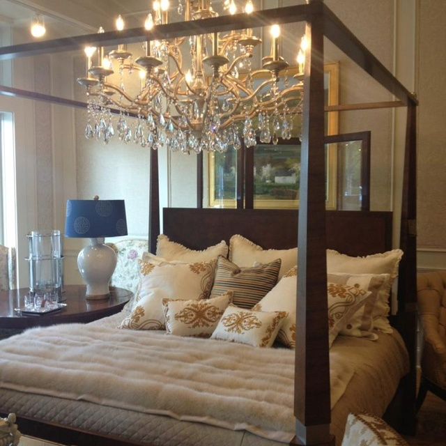 chandelier above bed master bedroom pinterest