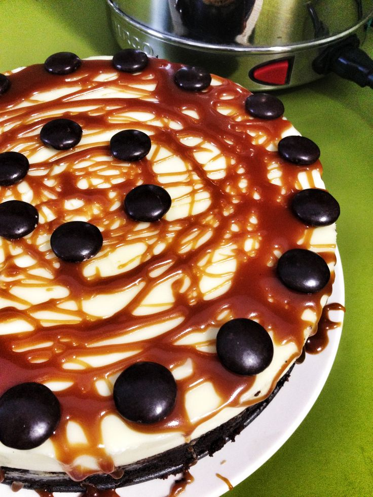 cake topped with white chocolate cheesecake and salted butter caramel ...