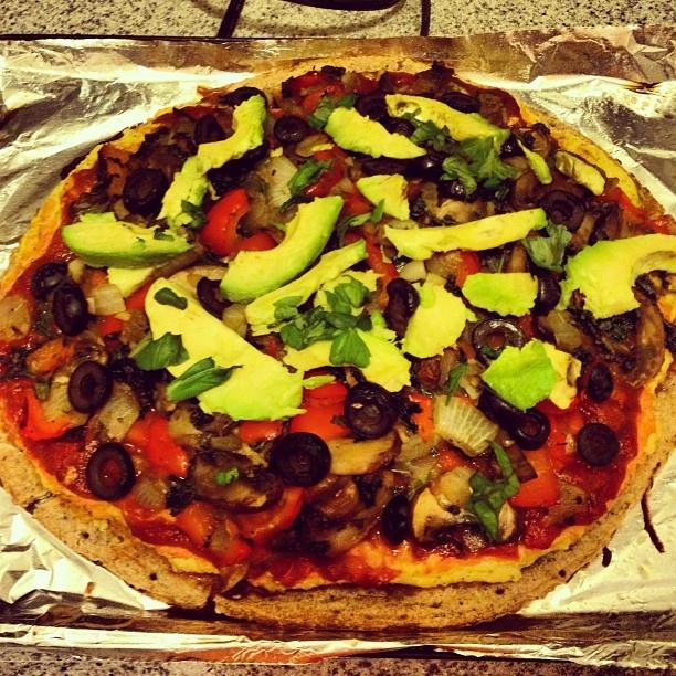 Avocado garlic basil kale/veg pizza. Top with veggies, olives, avocado ...