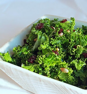 Kale, dried cherries, and pine nuts come together to create a salad so ...