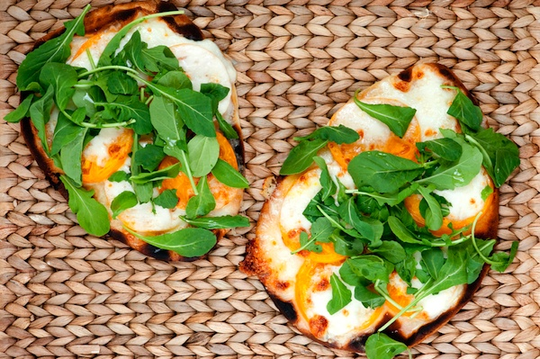 More like this: arugula pizza , tomatoes and pizza .