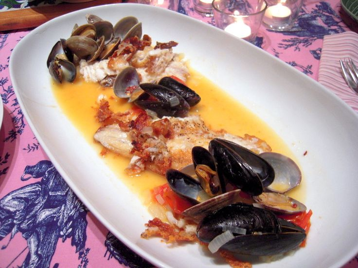 Sautéed red snapper fillets in garlicky clam and mussel sauce