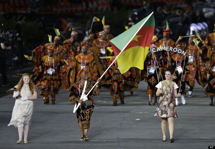 Cameroon's Annabel Laure Ali carries her country's national flag during the Opening Ceremony at the 2012 Summer Olympics, Friday, July 27, 2012, in London.