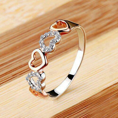 Gorgeous for a promise ring. But not gold; either silver or rose gold.