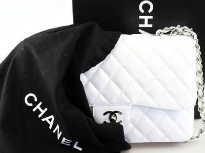 Peek-a-boo #Chanel! White Jumbo Caviar Classic Flap #SocialiteAuctions