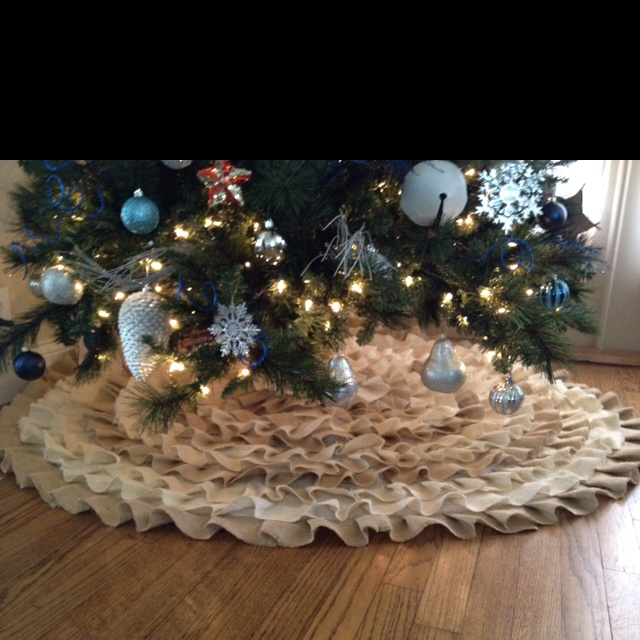 Christmas tree skirt i made from our wedding center pieces