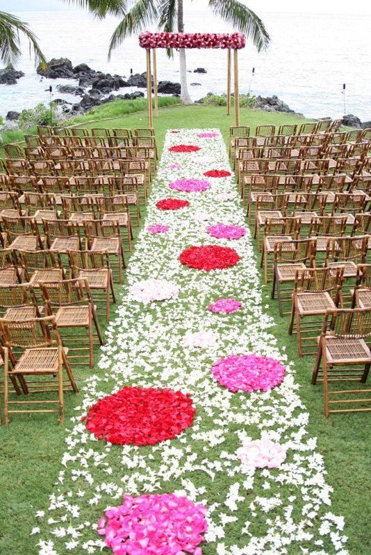 Rose petals are very versatile decorations. Simple same-color aisle runners are very popular; however, unique designs are not uncommon.