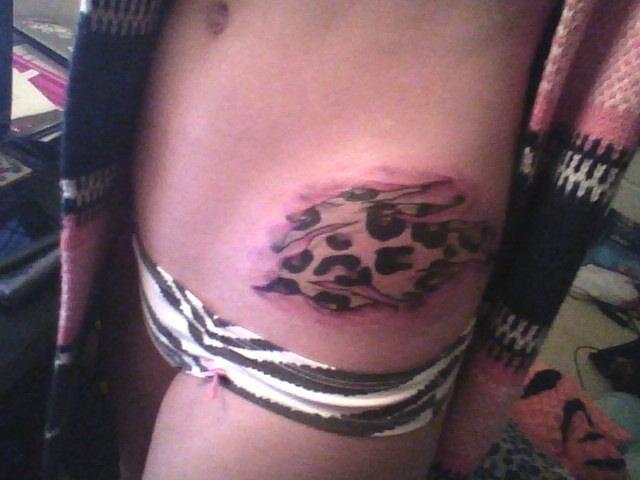 Cheetah scratch tattoo on hip - photo#23