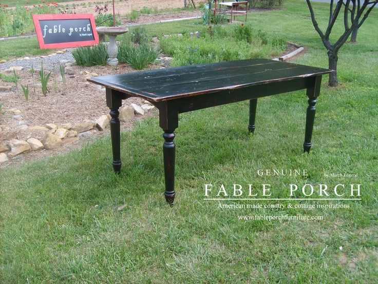 Our original plank top Farmhouse dining table finished in Midnight over Sicily with Summer distressing.