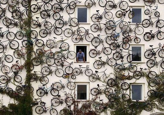 Bike Shop Attracts Buyers with 120 Bikes Mounted to the Facade - The co-owner of a bicycle shop in Altlandsberg, Germany, Christian Peterson decided to forgo the traditional storefront sign — instead he mounted his entire inventory of 120 bikes for passers-by to see. An ingenious way to advertise his shop, save some space, and promote green transportation. | #Art #Installation #Bikes #StoreFacade |