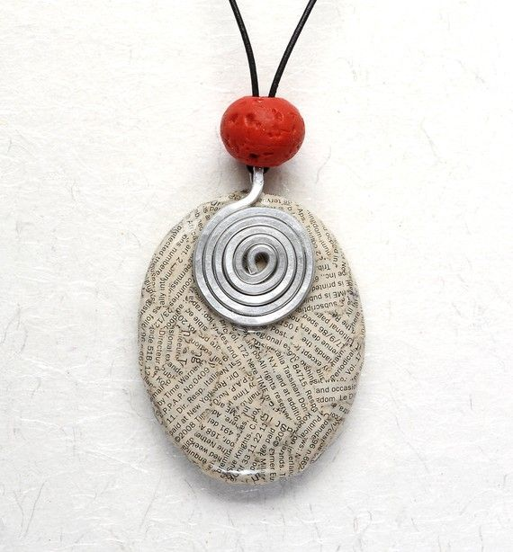 Jewelry pendant made from old book pages.  Cool.