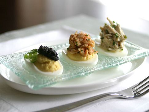From Acadiana, a trio of deviled eggs topped with crab ravigote ...