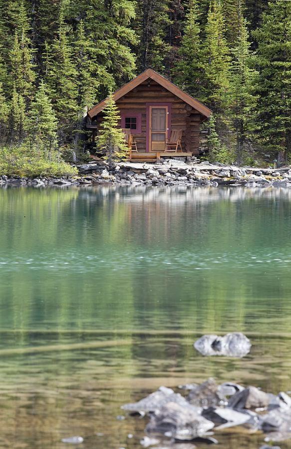 Wooden Cabin Along A Lake Shore Print By Michael Interisano