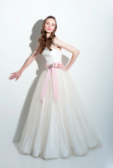 With full polka dot tulle skirt and sash by fancy new york gowns