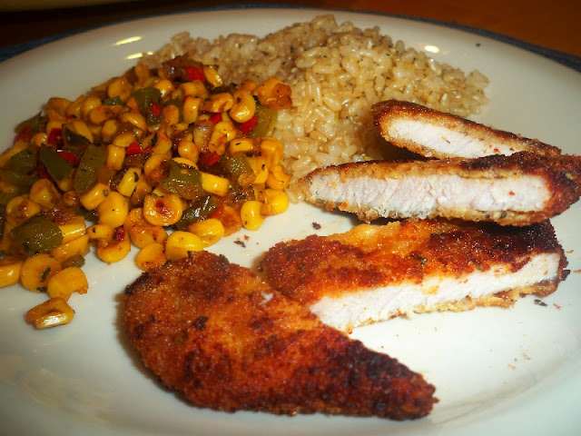 Savory boneless pork chops, skillet fried corn, and baked brown rice