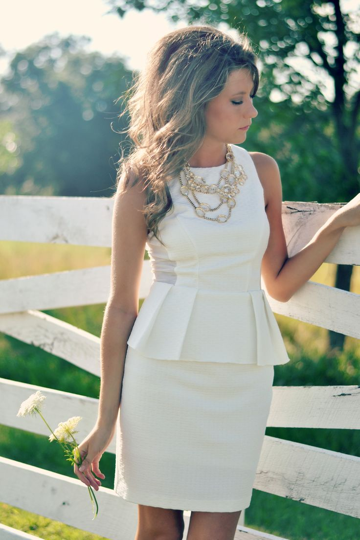White Peplum dress + statement necklace. Considering this one for my civil wedding =D