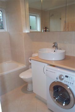 Small laundry bathroom for the home pinterest for Small bathroom designs with washer and dryer