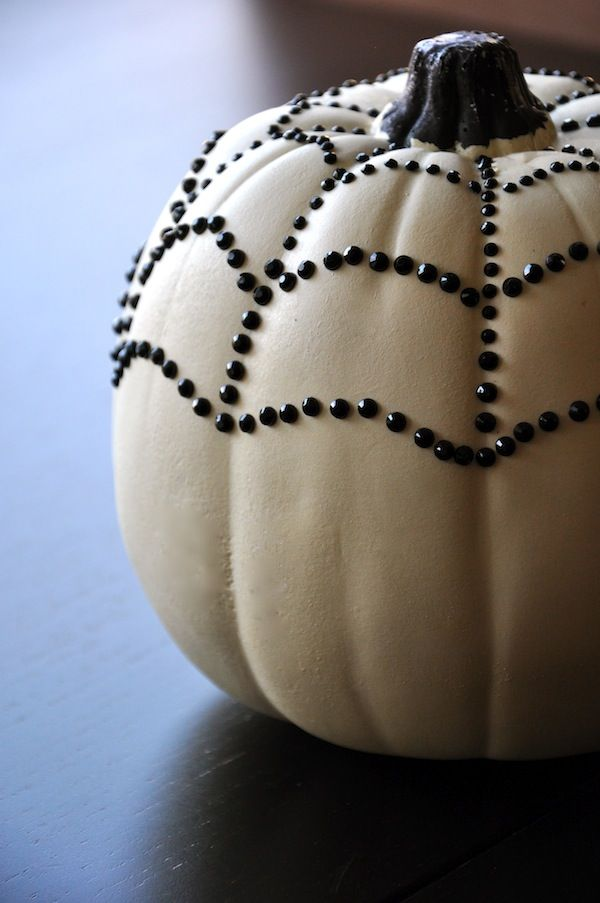 From FlowerDuet.com: Create your own Black and White Halloween Pumpkin with a fake Ghost Pumpkin and black Rhinestones