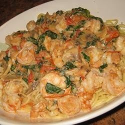 creamy shrimp sauce with spinach, mushrooms, and tomatoes over ...
