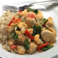 Thai Chicken Vegetable Curry   2 tsp oil 1 red bell pepper 1 onion,1 clove garlic 1tbls ginger 1 1/2 tsp red curry paste 1 lb skinless chicken 1c chicken broth 1 c coconut milk 1 tbls soy sauce 1 tsp brown sugar 1 1/2 c cauliflower 2 c spinach 1 tbls lime juice  Heat oil in a large skillet, add bell pepper onion to soften add garlic ginger curry paste chicken cook 2 min Add broth, coconut milk, soy sauce  brown sugar cauliflower cook chicken & cauliflower add spinach & lime juice wilt spinach