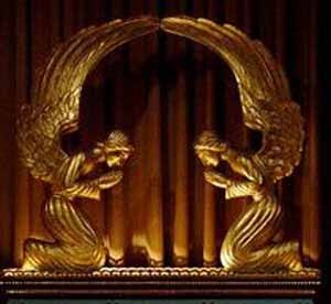 Depiction -- top of the Ark of the Covenant -- angels with wings touching